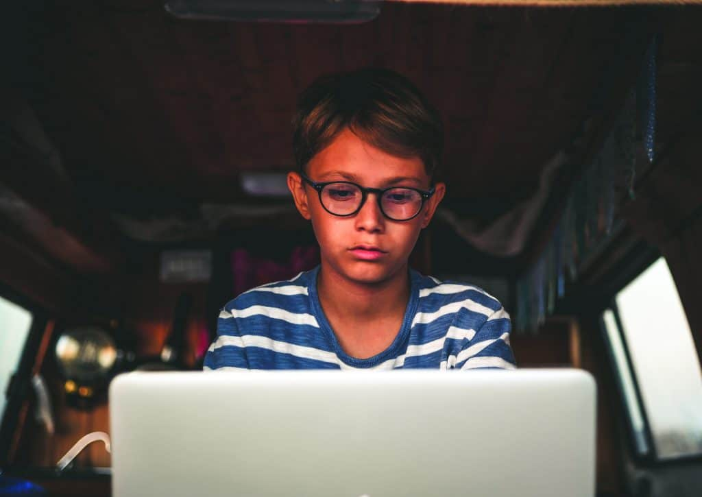 Boy on computer learning at home